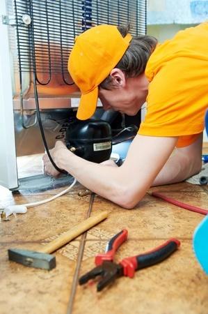repairman fixing the fridge